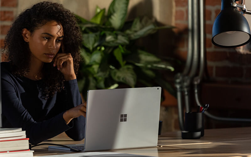 A woman using Surface Book 3 for Business