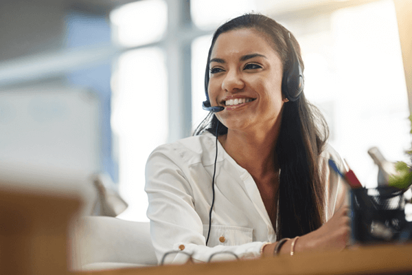 Smiling call center representative taking calls